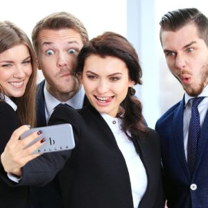 Business professionals taking a selfie