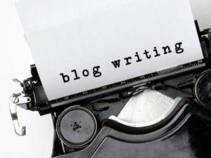 Paper in typewriter that says Blog Writing