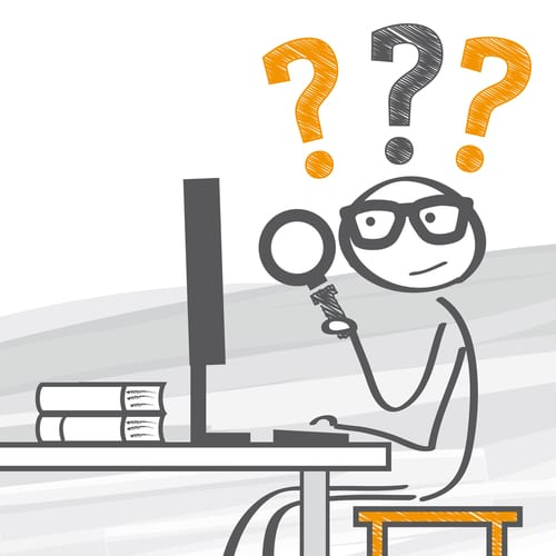 Man is setting at computer with a magnifying glass and question marks over his head