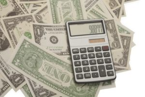 Calculator and American currency reflecting the returns on lead cultivation