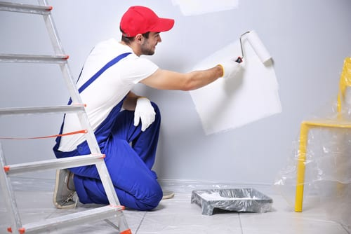 man-is-painting-a-house-white