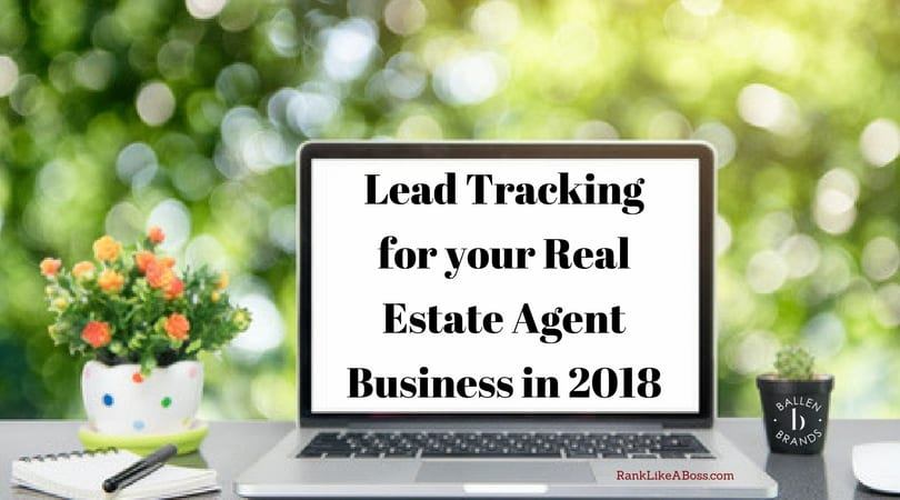 computer is facing a window, next to it is a pen and a plant, computer screen has letters that spell out the words lead tracking for your real estate agent business in 2018