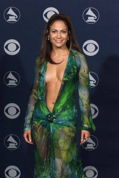 Jennifer Lopez is in a green, plunging neckline (to naval) designed by versace