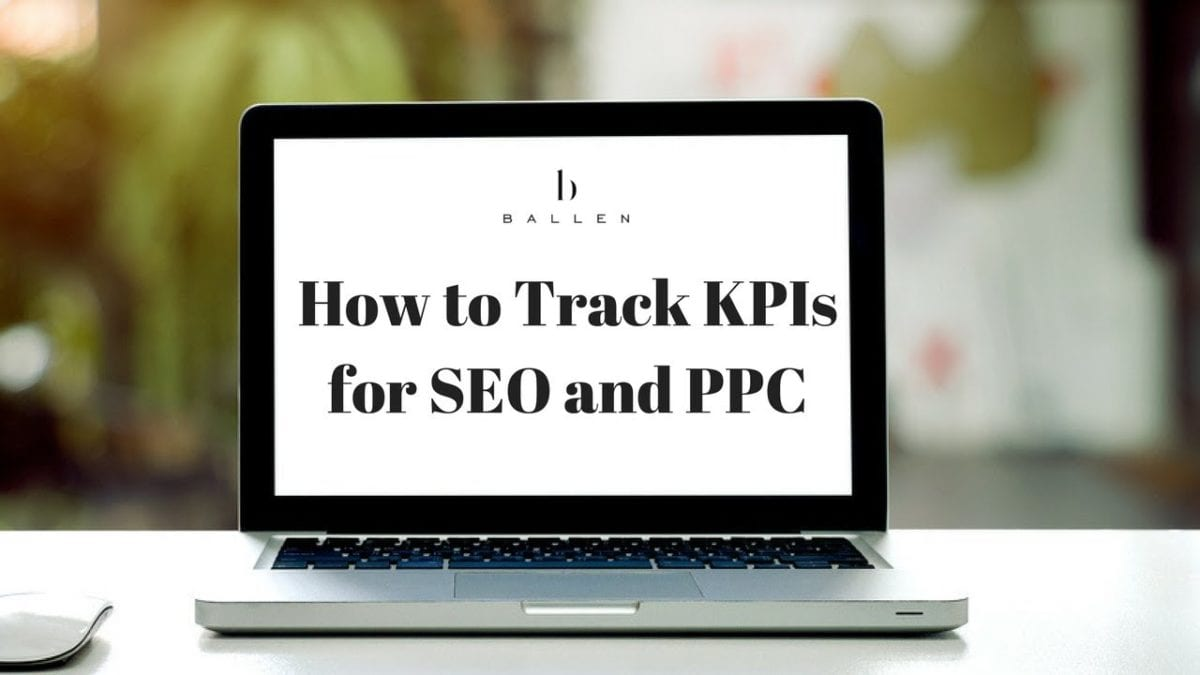 Computer screen on desk with ballen logo and sign reads how to track kpis for seo and ppc