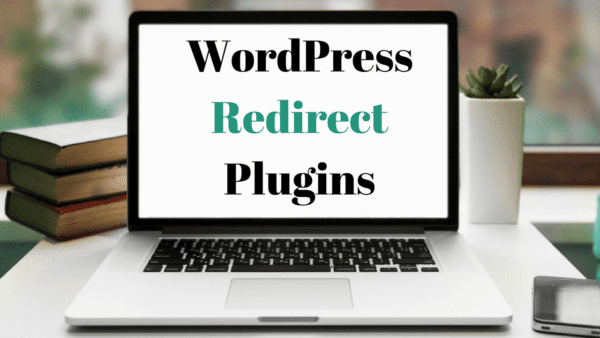 "A computer on a desk displaying the text ""WordPress Redirect Plugins"""