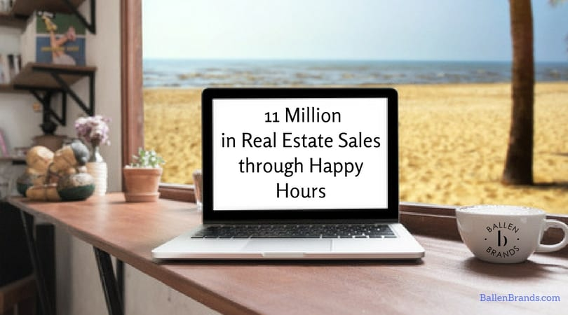 Computer is sitting on a table in front of a window. There's a beach right outside the window. Words on the screen say 11 million in real estate sales through happy hours
