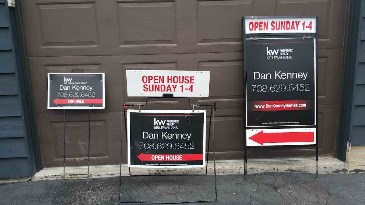 3 open house signas are against a wall and say open house times and agent information