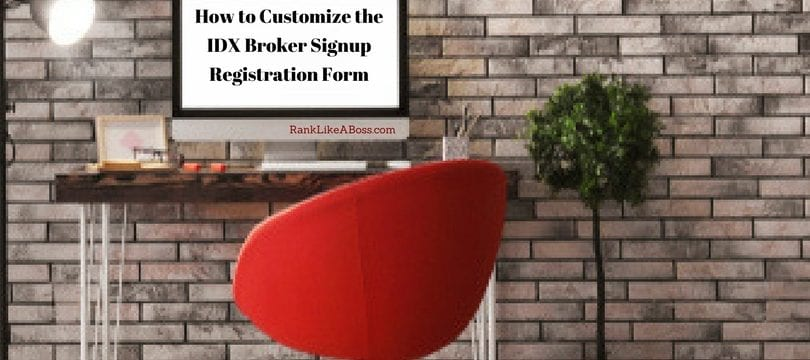 cool looking office space, red chair, tall plant, modern nighting, brick wall, computer screen has words that spell out How to Customize the IDX Broker Signup Registration Form