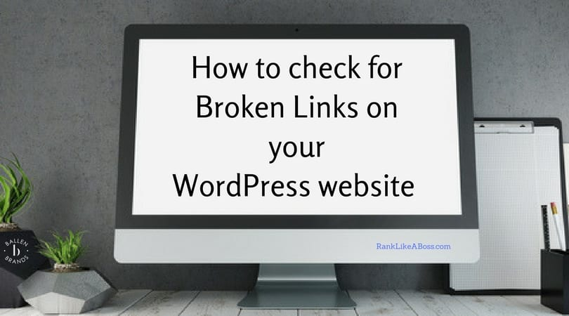 Full size desktop computer is on a desk and the screen reads how to check for broken links on your wordpress website
