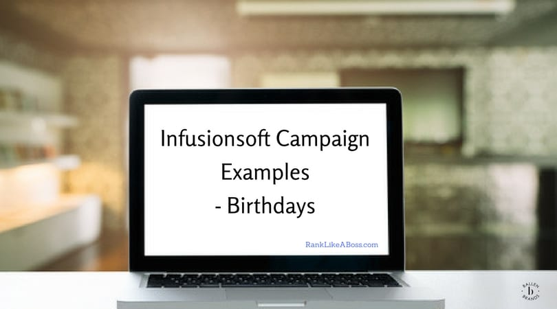 "Computer is sitting on a table and is open. It reads ""Infusionosft Campaign Examples - Birthday"""