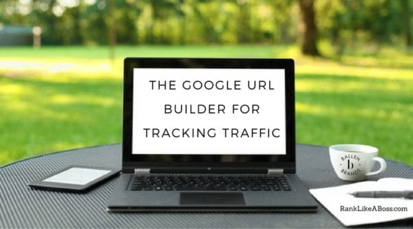 computer is on a table outdoors and the words spell out the google url builder for tracking traffic