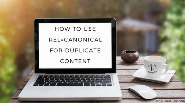 laptop computer on a table is outside and the words spell out how to use rel-canonical for duplicate content