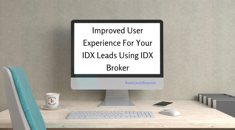 A desktop computer is on a table with a keyboard, mouse, phone and coffee mug with the Ballen Brands logo on it. The words on the screen spell out improved user experience for your idx leads using idx broker