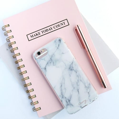pink planner with make today count engraved with phone and pen