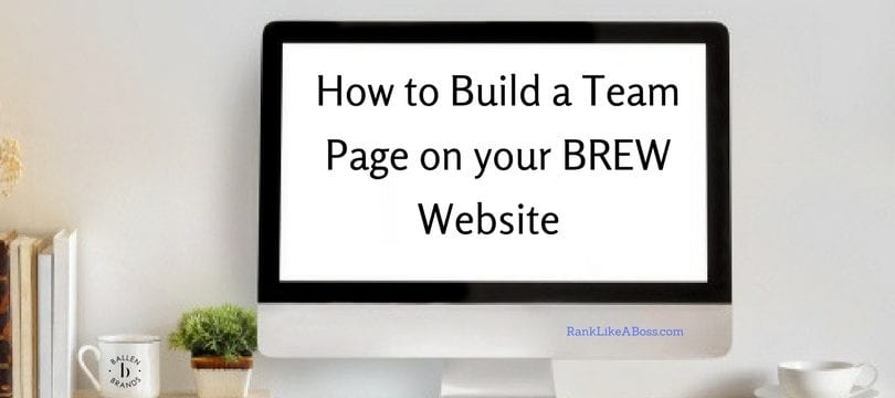 Large desktop computer against a grey wall spells out the words how to build a team page on your real estate website
