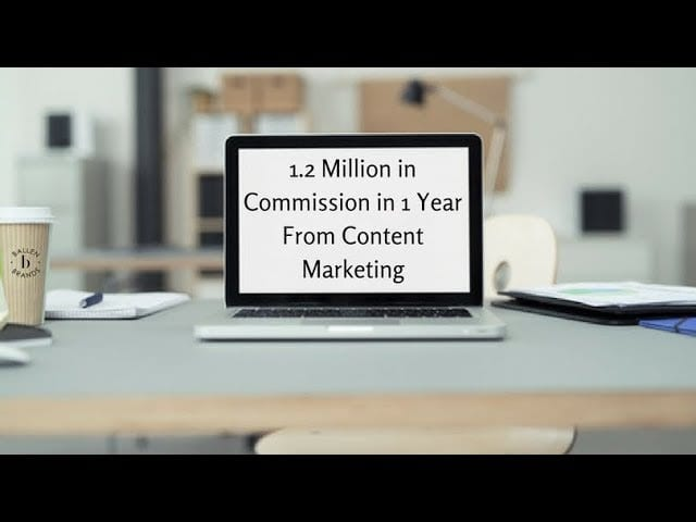 Computer on a table has words on the screen that sepll out 1.2 million in commission in 1 year from content marketing