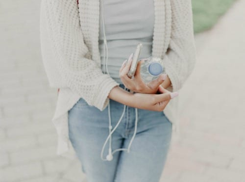 woman carrying water bottle and phone