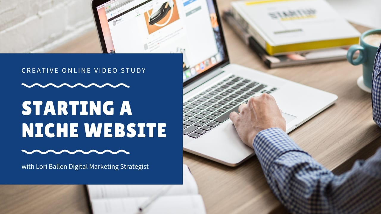 person is on a computer and the sign says starting a niche website