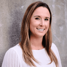 Casie Gilette of KoMarketing presents at the MozCon 2019 Convention.